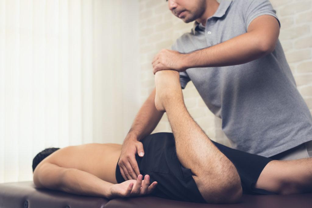 stretching man's leg